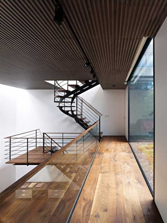 interior design of a floor in brown wood and white colored walls
