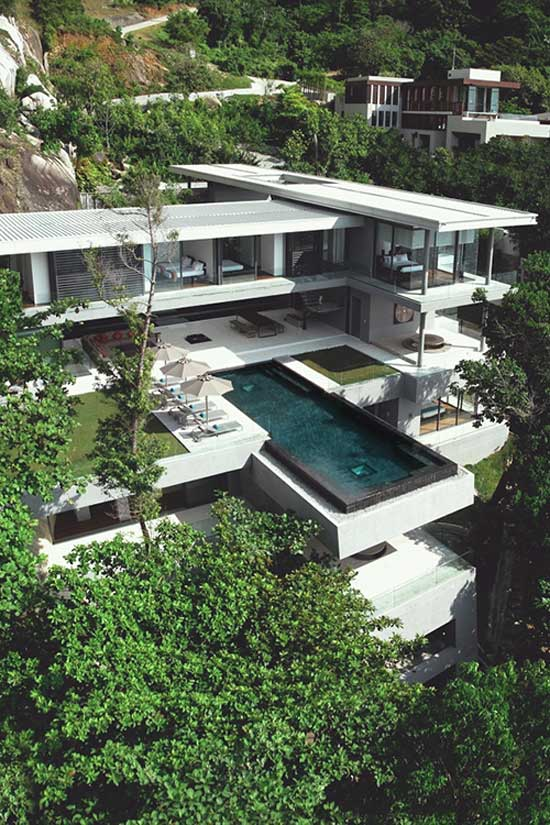 minimal design of a pool and house on a cliff
