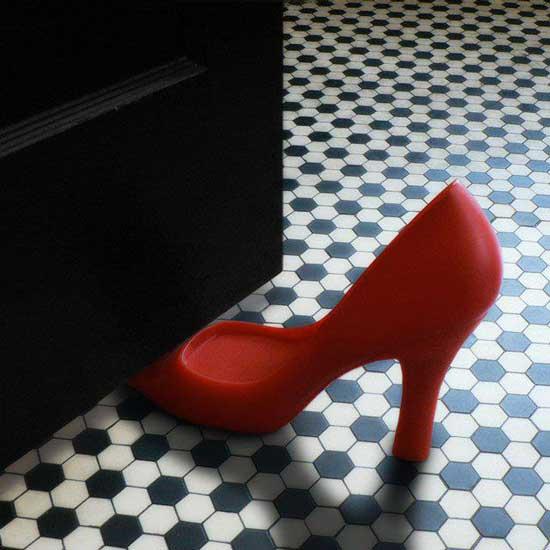 red high heel door stop