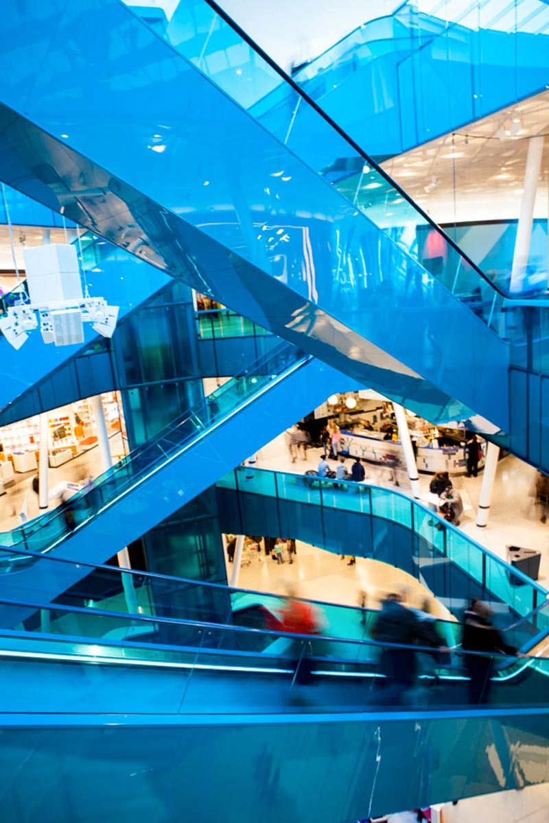 interior blue escalators at the Emporia shopping center in Malmo, Sweden