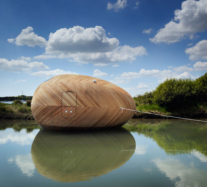Exbury Egg tied to a dock on the water on a sunny summer day