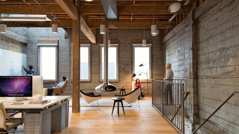 Fireplace, chimney and seats and desks at the Giant Pixel headquarters in San Francisco designed by Studio O+A