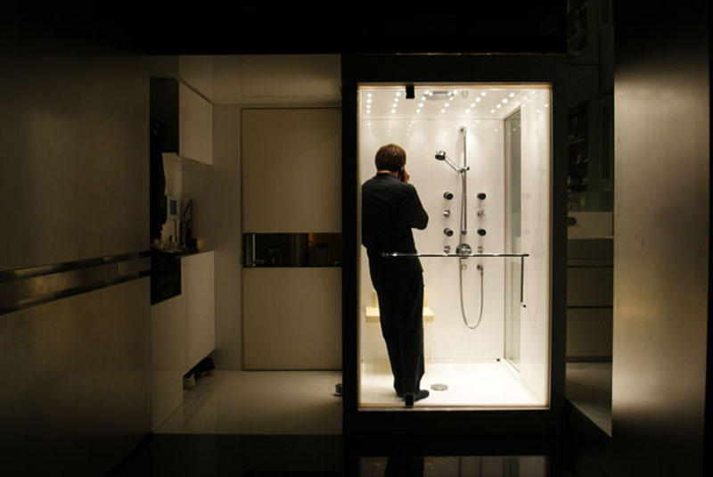 Gary Chang in the shower of his Hong Kong micro apartment