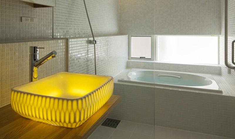 LED illuminated sink in the bathroom designed by Souhougama