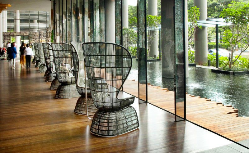 seats lined up near the windows at the Parkroyal Singapore
