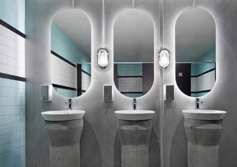 Bathroom sink and mirrors at Prahran Hotel