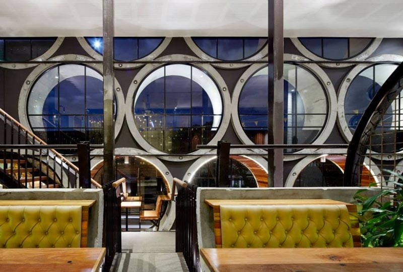 dining booth and view of the exterior through pipe windows at Prahran Hotel in Victoria