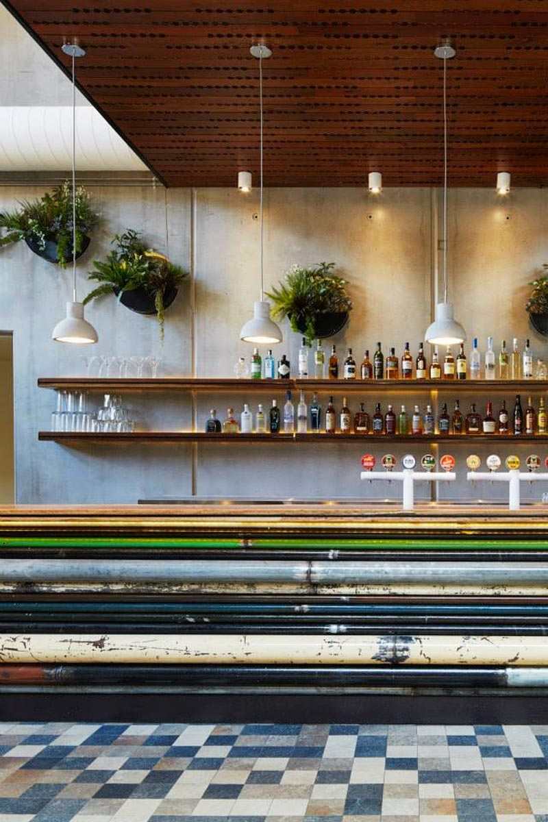bar with bottles and plants at the Prahran Hotel in Victoria