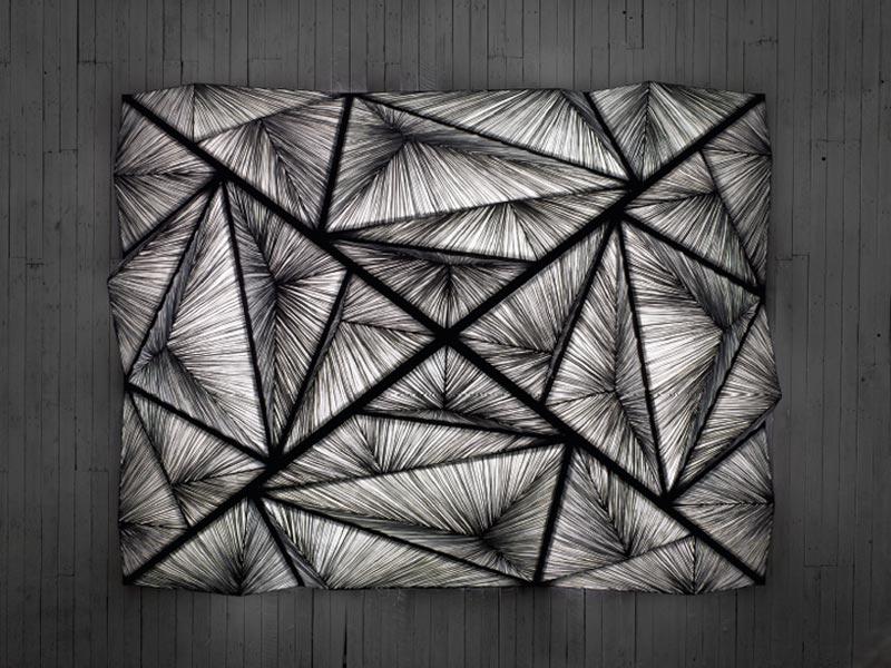 black and gray pyramid lighting sculpture