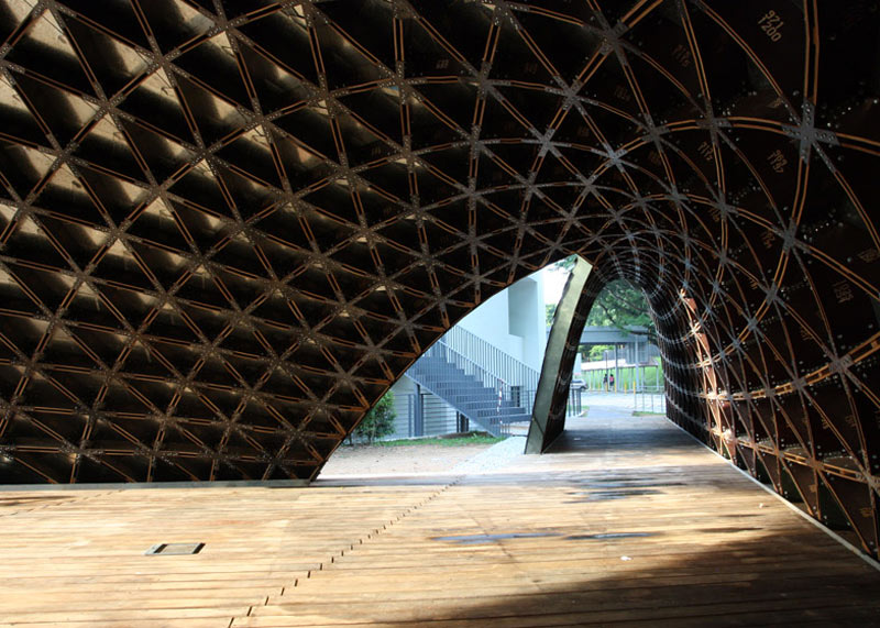 Interior view of the arc made out of plywood boards at the SUTD Library Pavilion designed by City Form Lab
