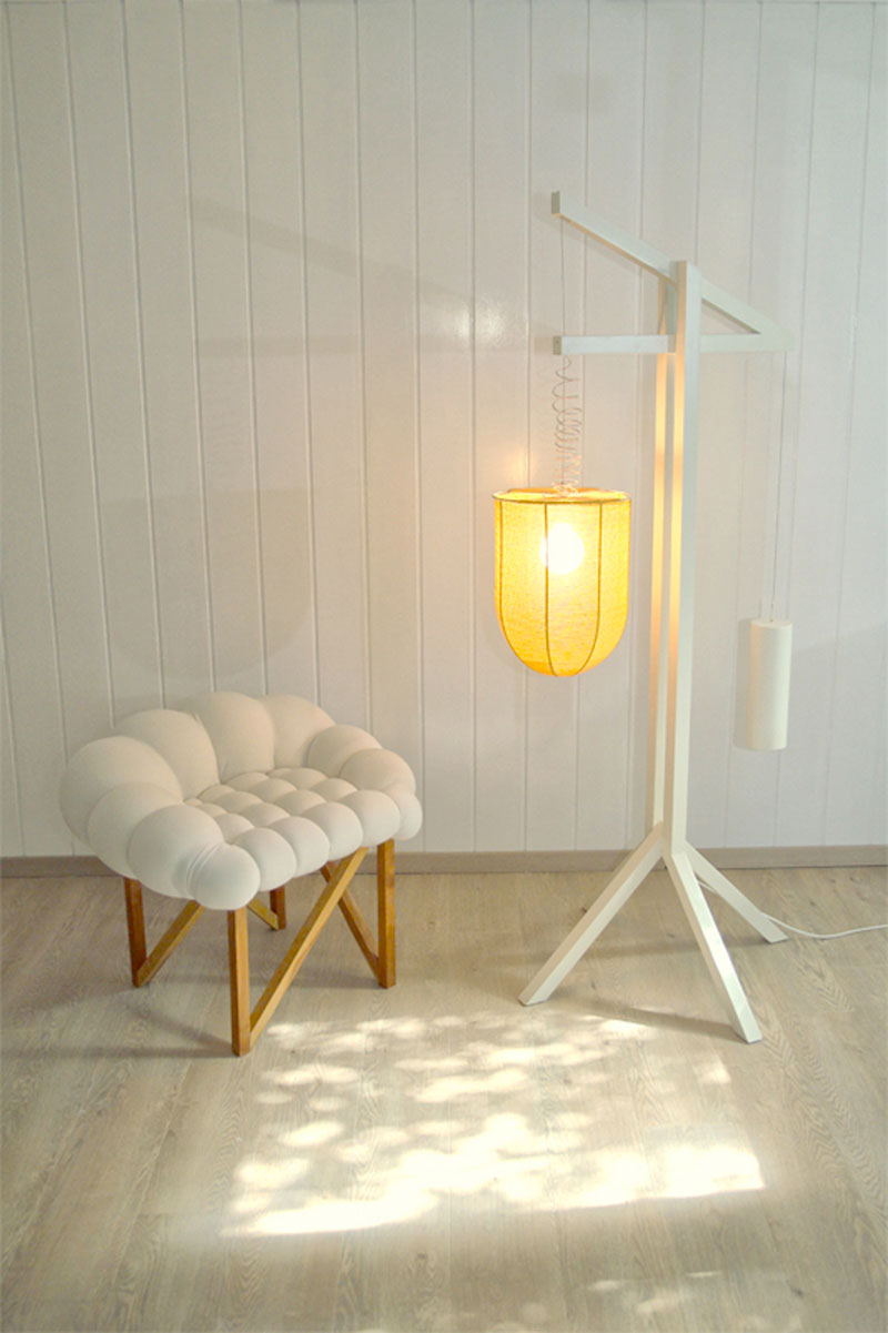 Snobar chair and lamp in a room with white walls