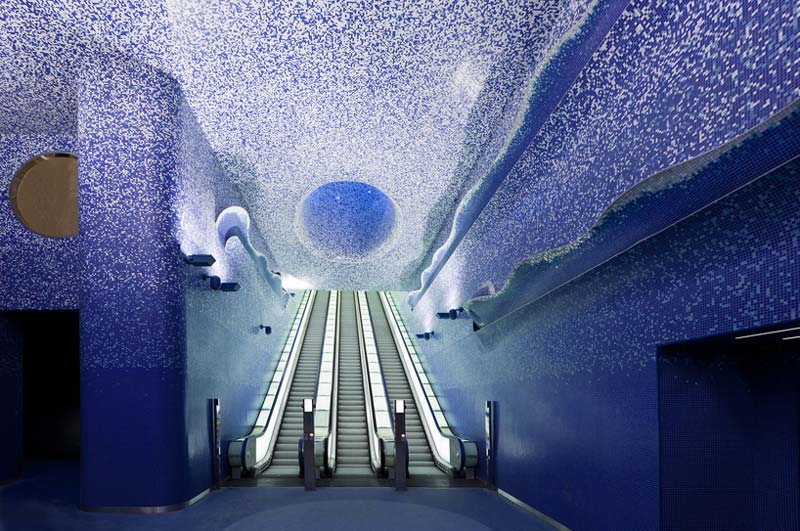 3 sets of escalators and illuminated ceiling at the Toledo Metro Station designed by Oscar Tusquets Blanca