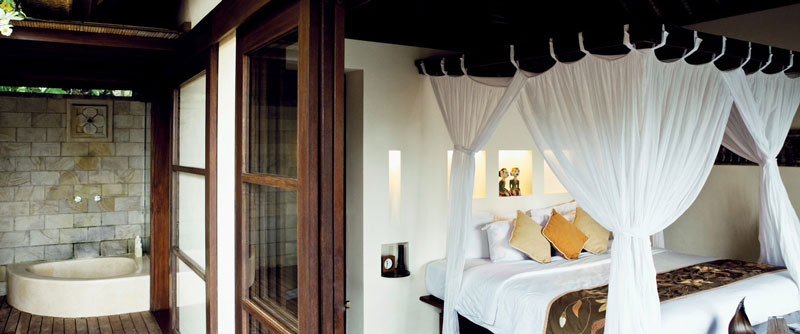 bed and windowns in bedroom at the Ubud Hanging Gardens