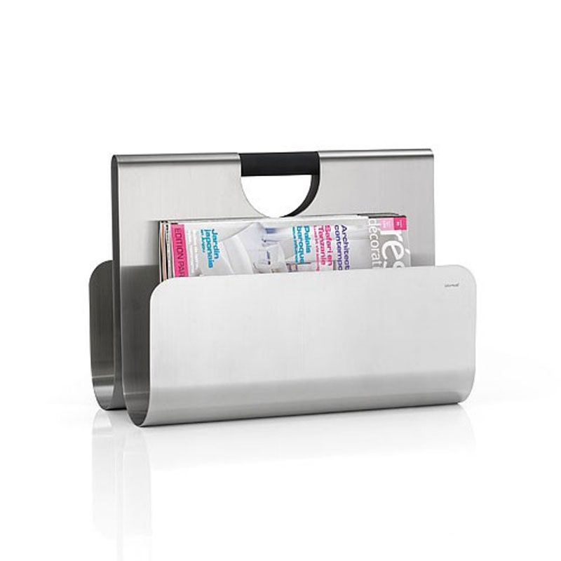 Magazine rack by Blomus in with a magazine and white background