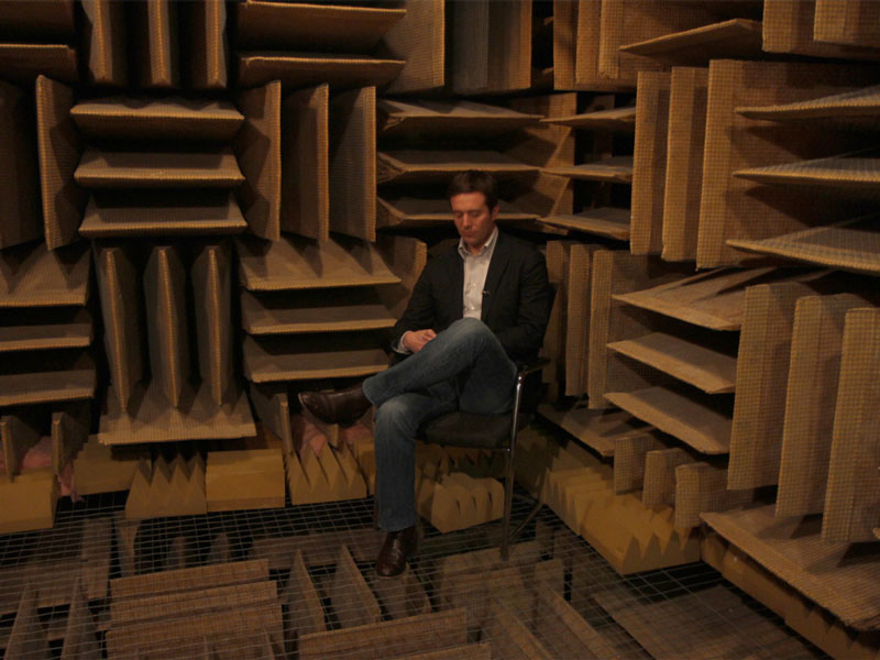 men sitting in the world's quietest room in Orfield Labs in Minneapolis