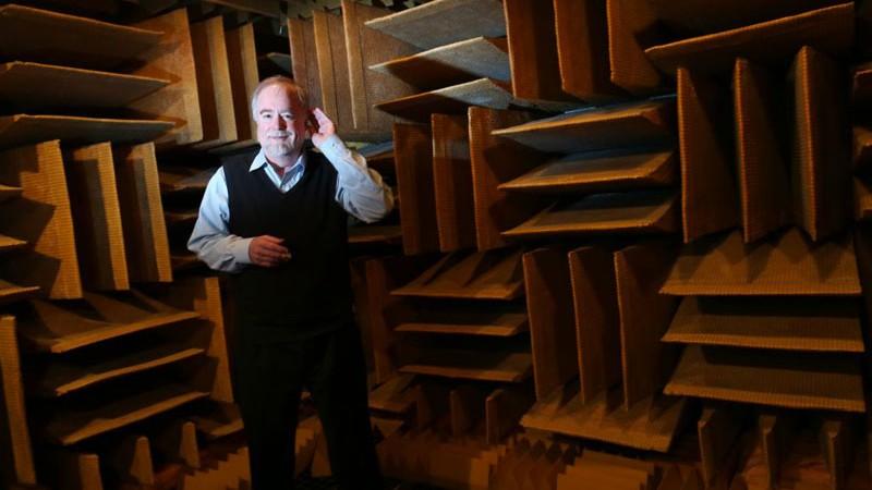 men standing in the world's quietest room in Orfield Labs in Minneapolis