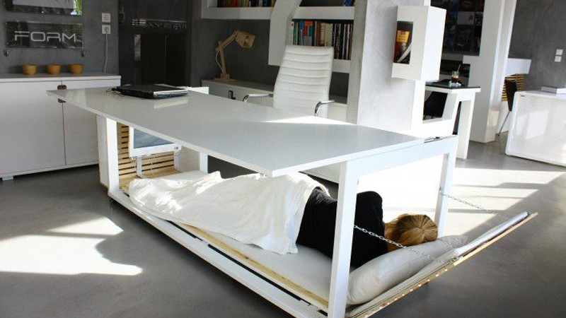 work desk bed with a person sleeping inside Studio NL 1