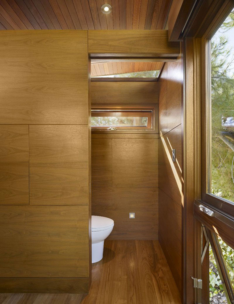 Bathroom with wooden floors and walls at The Banyan Treehouse by Rockefeller Partners Architects