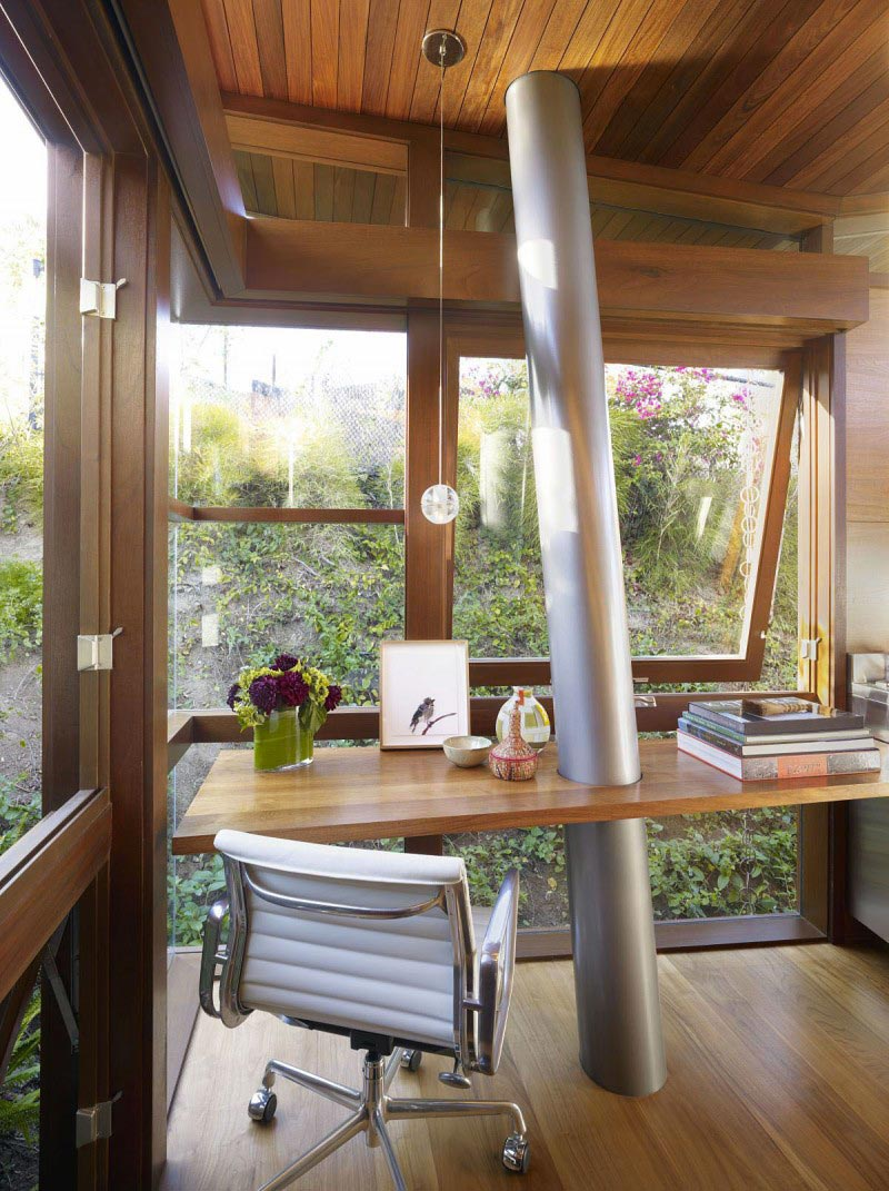 Work desk and white swivel chair at the The Banyan Treehouse by Rockefeller Partners Architects