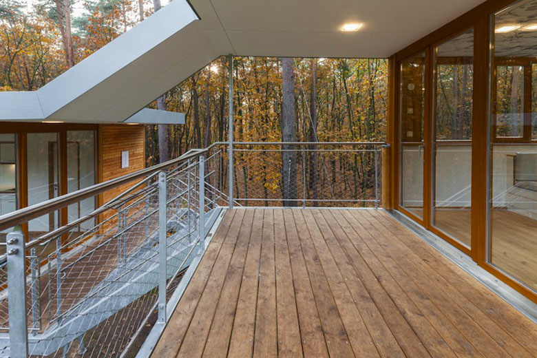 Patio area with wooden floors at Baumraum's Treehouse Retreat