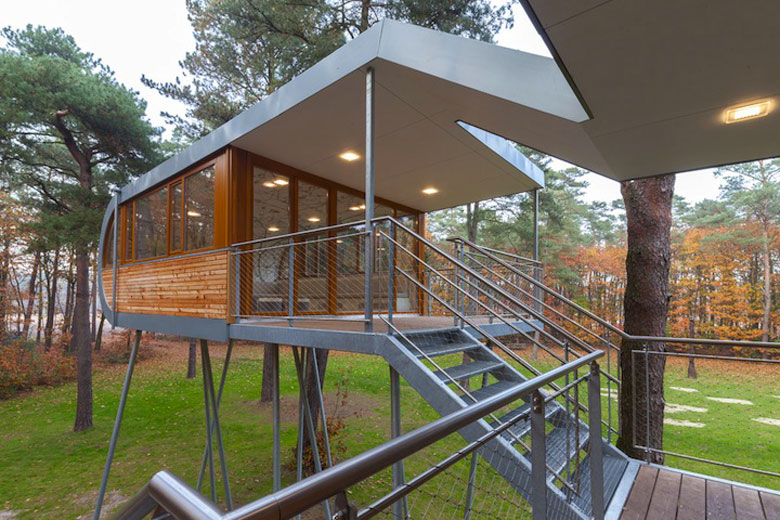 Exterior view of Baumraum's Treehouse Retreat and the metal stairs that take connect to it