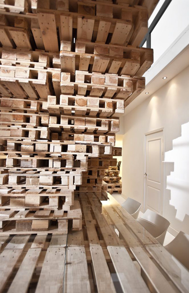 Stacks of pallet at the Brandbase Pallet Office by MOST Architecture