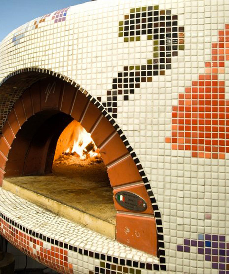 Wood pizza oven at the Fabbrica Restaurant in Bergen by Tjep Studio