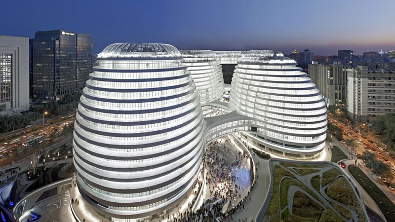 Aerial view during the evening of the Galaxy SOHO Complex in Beijing by Zaha Hadid