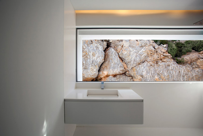 Interior design of a sink and window of the House on the Cliff by Fran Silvestre Arquite