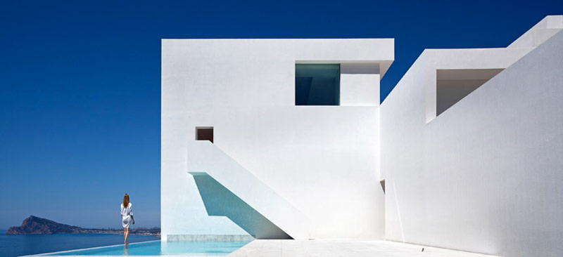 Swimming pool, white walls and stairway of the House on the Cliff by Fran Silvestre Arquitectos