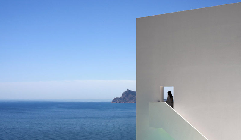White wall and staircase overlooking the ocean at the House on the Cliff by Fran Silvestre Arquitectos