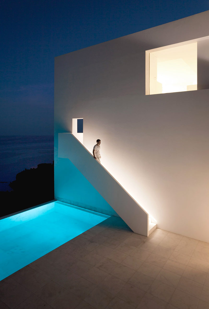 Swimming pool and white minimal stairway of the House on the Cliff by Fran Silvestre Arquitectos