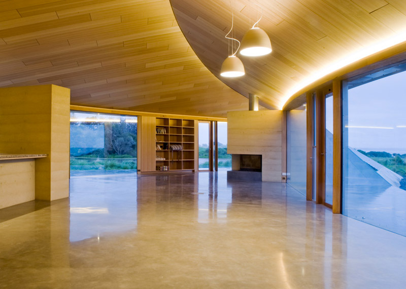 Interior design of a large and empty space with a wooden celing at the Crofthouse by James Stockwell