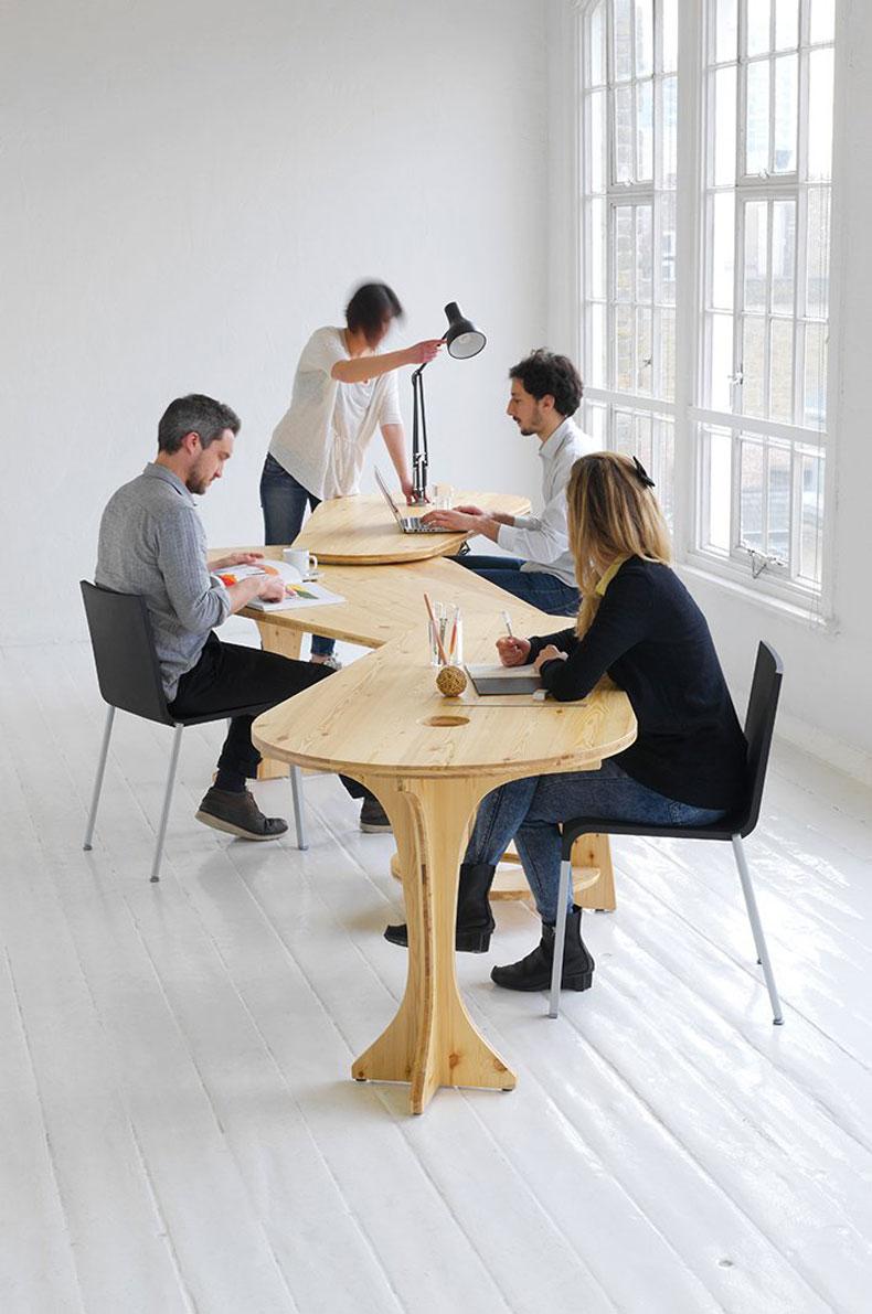 Employess working using the LeafDesk by Studio TILT