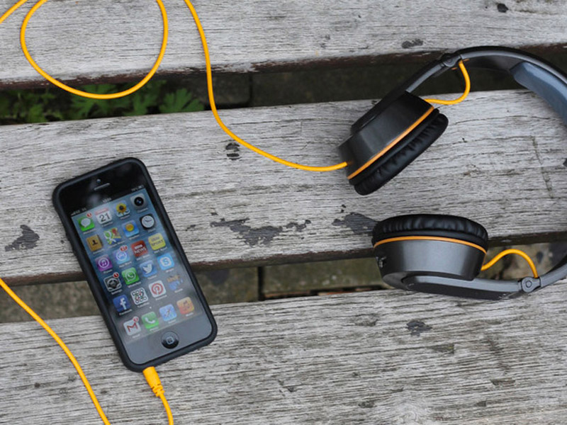 OnBeat solar powered headphones charging an iPhone 5