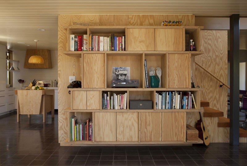 Wood shelving unit at the Exterior architecture view of the Smith Clementi Residence by Rios Clementi Hale Studios