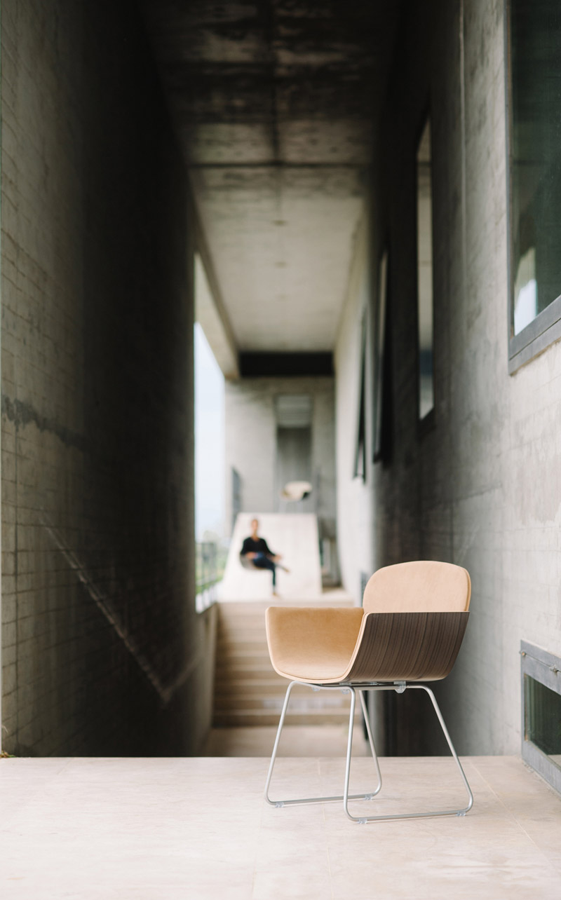 Light Brown interior and dark brown exterior wood of the Suri Chair by Pedro Gomes