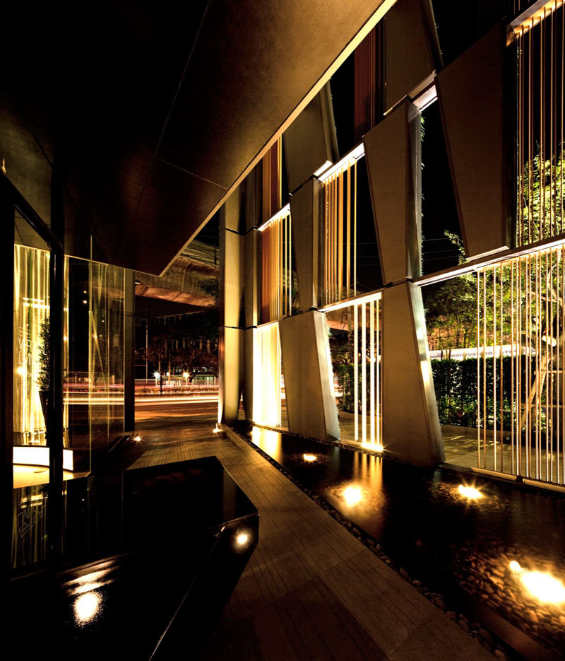 Interior design of a pond and windows at the Vertical Living Gallery by Sansiri and Shma in Bangkok