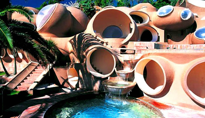 Swimming pool and housing units at the palais bulles, palace of bubbles Pierre Cardin house by antti lovag in Cannes