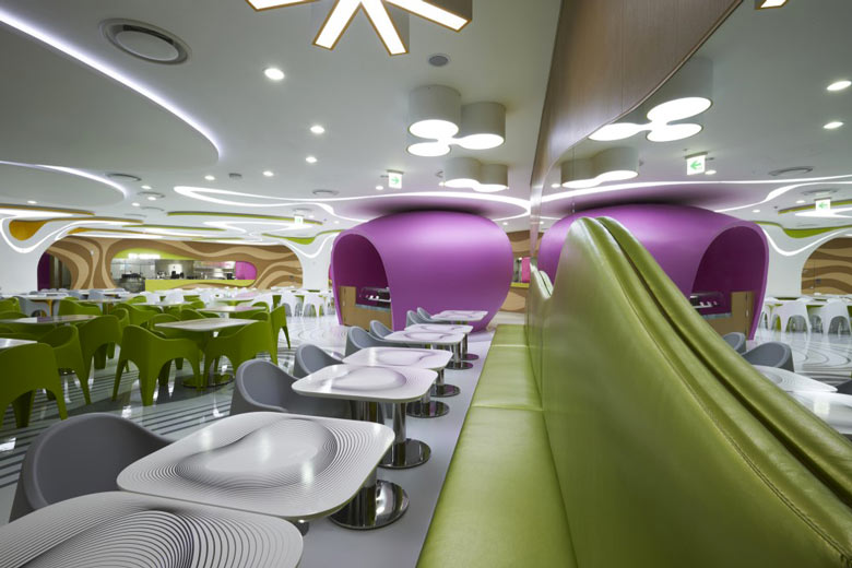 Green bench and white tables at the Amoje Food Capital in Lotte Shopping Mall by Karim Rashid