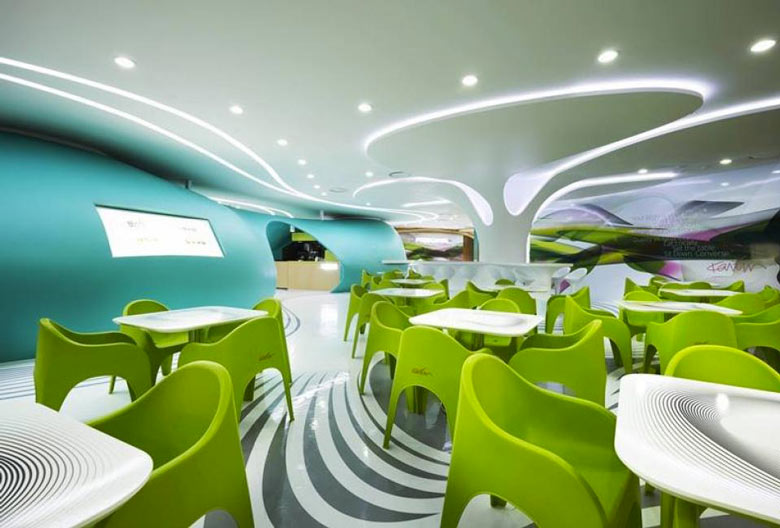 Green chairs and white tables at the Amoje Food Capital in Lotte Shopping Mall by Karim Rashid