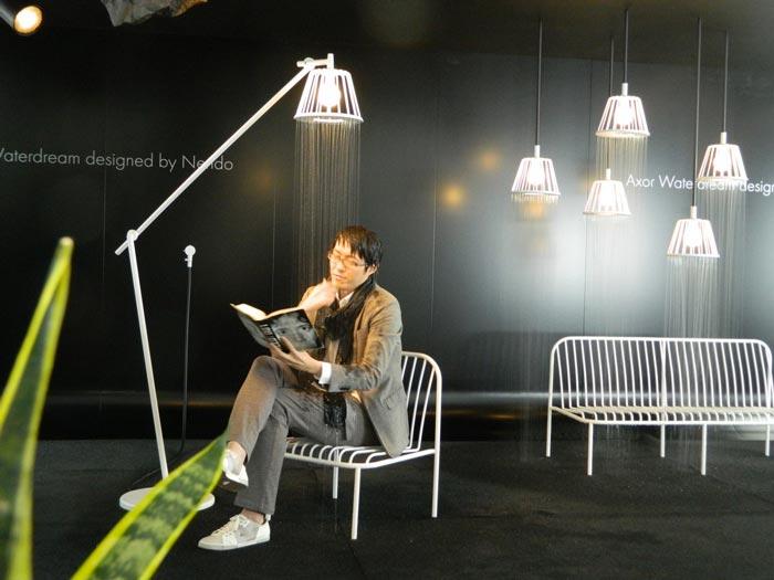Creator Oki Sato under the Axor Waterdream Shower Head by Nendo