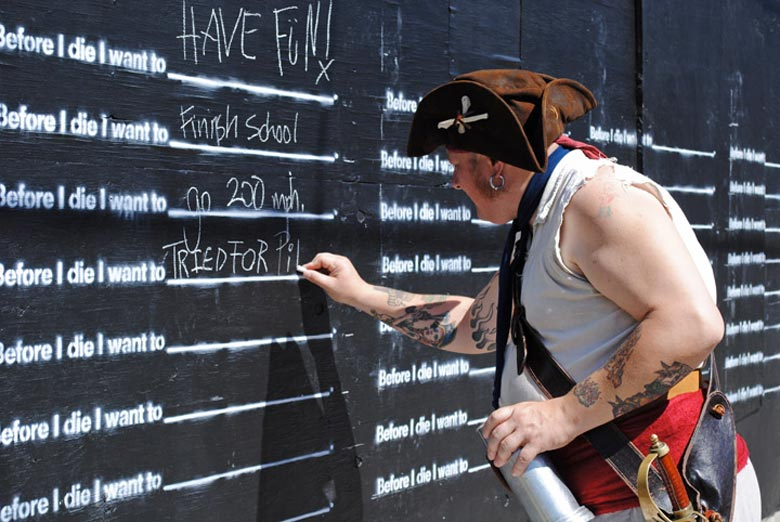 Pirate writing on the Before I Die wall by Candy Chang