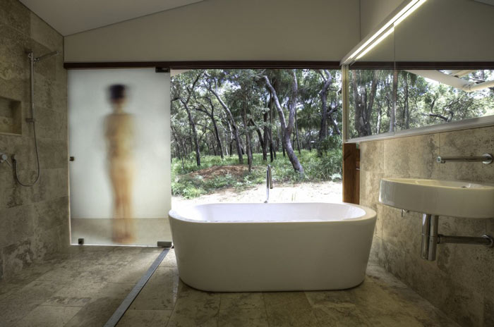 White baththub in the bathroom at the Drew House by Simon Hills of Anthill Constructions