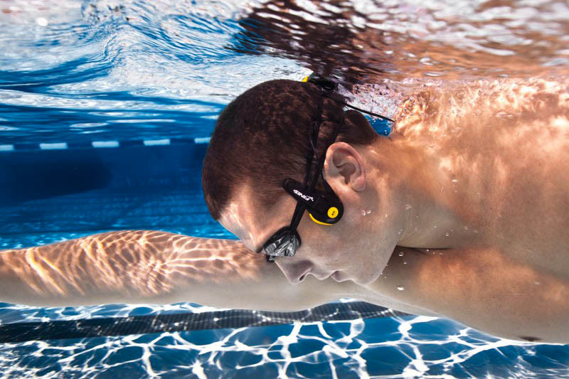 Swimmer underwater using the FINIS Neptune Waterproof MP3 Player