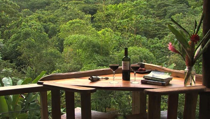 Wooden table and chair at the Finca Bellavista Treehouse Community in Costa Rica
