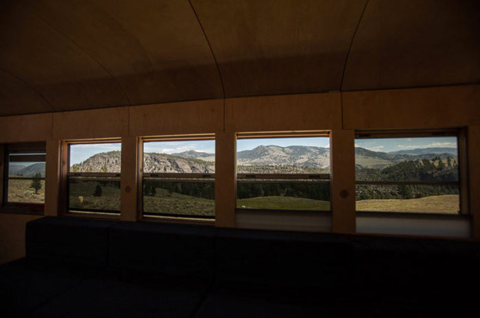 Open windows of 'Hank's converted school bus'with a view of the outside landscape