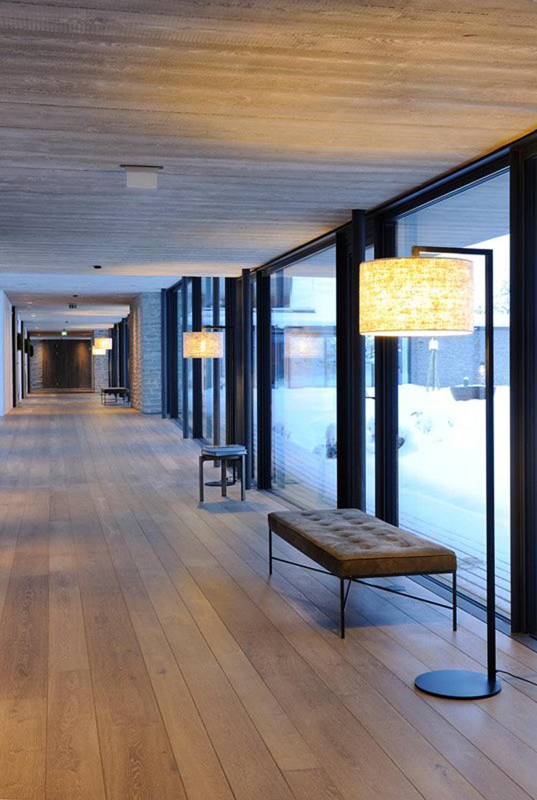 Floor to ceiling windows and benches at the Hotel Wiesergut in Hinterglemm Austria by Gogl Architekten