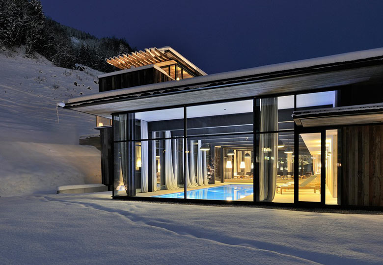 View of the swimming pool from the outside at the Hotel Wiesergut in Hinterglemm Austria by Gogl Architekten