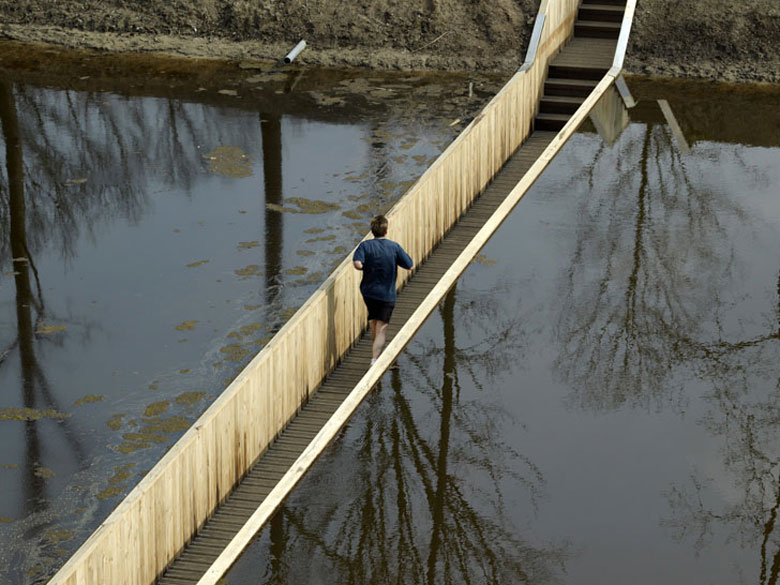 Man running across the Moses Bridge, Sunken Bridge in The Netherlands